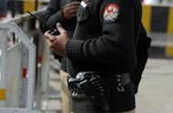 <p>File photo of Pakistani police on patrol in Lahore. Gunmen on Thursday shot dead eight Pakistani police and prison staff, and wounded nine others after storming a building in the eastern city of Lahore where they were sleeping, police said.</p>
