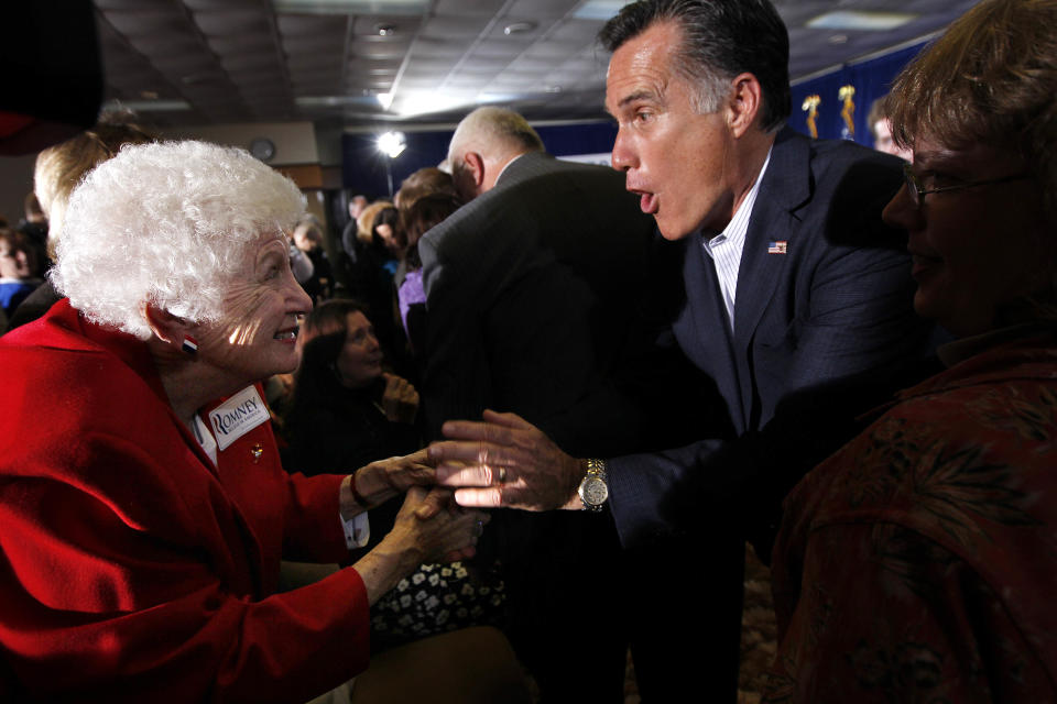 Republican presidential candidate, former Massachusetts Gov. Mitt Romney, greets supporters at a town hall meeting in Kalamazoo, Mich., Friday, Feb. 24, 2012. (AP Photo/Gerald Herbert)
