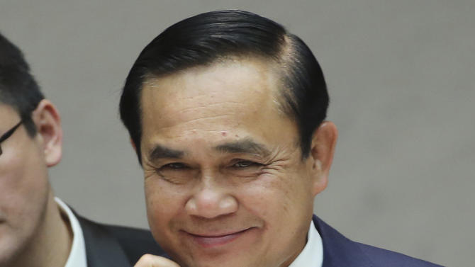FILE - In this Monday, Feb. 9, 2015, file photo, Thailand's Prime Minister Prayuth Chan-ocha smiles during a welcome luncheon hosted by Japan Business Federation in Tokyo. Since leading a putsch that ousted Thailand's elected government last May, general-turned-prime minister Prayuth Chan-ocha has been thrust from the relative privacy of army life into the public arena of the politician. (AP Photo/Koji Sasahara)