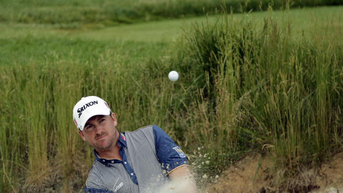 Graeme McDowell, of Northern Ireland, hits out of a bunker on the 17th hole during practice for the U.S. Open golf tournament at Merion Golf Club, Wednesday, June 12, 2013, in Ardmore, Pa. (AP Photo/Charlie Riedel)