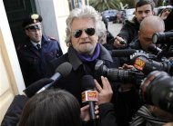 Five Star Movement leader and comedian Beppe Grillo speaks with media after casting his vote at the polling station in Genoa February 25, 2013. Italians began voting on Sunday in one of the most closely watched elections in years, with markets nervous about whether it can produce a strong government to pull Italy out of recession and help resolve the euro zone debt crisis. REUTERS/Giorgio Perottino