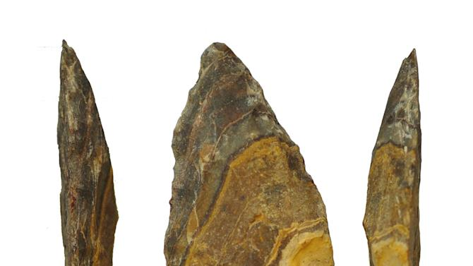 This undated image provided by Jayne Wilkins shows different angles of an estimated 500,000-year-old stone point from Kathu Pan, South Africa. The scale bar at bottom is 1 centimeter long. In a study published in the journal Science on Thursday, Nov. 15, 2012, scientists say they've found evidence that stone tips for spears were made much earlier than thought, maybe even created by an earlier ancestor than has been believed. Both Neanderthals and members of our own species Homo sapiens used stone tips - a significant development that made spears more effective, lethal hunting weapons. The new findings from South Africa suggest that maybe they didn't invent that technology, but inherited it from their last shared ancestor, Homo heidelbergensis. (AP Photo/Jayne Wilkins)