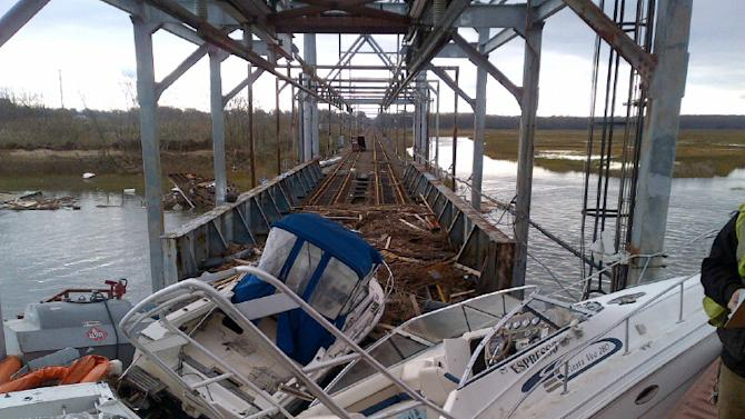 This undated photo made available by New Jersey Transit shows boats and other debris on New Jersey Transit's Morgan draw bridge in the aftermath of superstorm Sandy, in South Amboy, N.J. Most mass transit systems were shut down as a result of the storm's damage, leaving hundreds of thousands of commuters braving clogged highways and quarter-mile lines at gas stations. (AP Photo/New Jersey Transit)