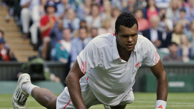 Jo-Wilfried Tsonga of France gets up after missing a return shot during a semifinals match against Andy Murray of Britain at the All England Lawn Tennis Championships at Wimbledon, England, Friday, July 6, 2012. (AP Photo/Anja Niedringhaus)