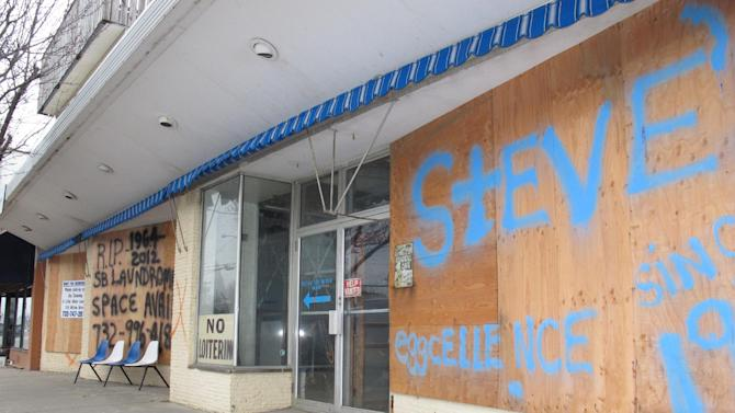 Most of the businesses in Sea Bright N.J. were shuttered on Jan. 15, 2013. The entire business district was wiped out by Superstorm Sandy (four shops have since re-opened) and 75 percent of residents are still homeless. Yet Sea Bright is determined to rebuild as a debate rages on whether to restore shore communities to their pre-storm condition, or buy out properties in flood-prone areas and depopulate them. (AP Photo/Wayne Parry)