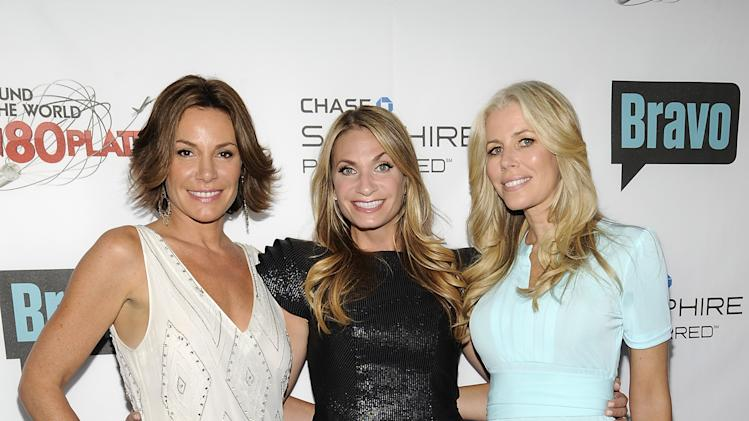 "COMMERCIAL IMAGE - Television personalities LuAnn de Lesseps, left, Heather Thomson and Aviva Drescher, right, attend the ""Around the World in 80 Plates"" Finale Sneak Peek Party presented by Chase Sapphire Preferred and Bravo on Thursday, July 12, 2012 in New York,. (Photo by Evan Agostini/Invision for Chase Sapphire Preferred/AP Images)"
