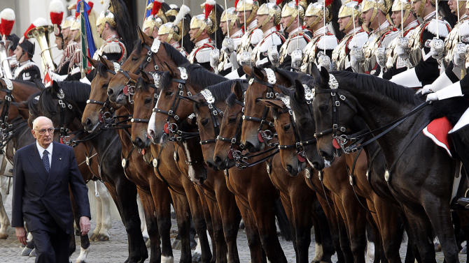 "FILE - In this May 15, 2005 file photo newly elected Italian President Giorgio Napolitano reviews mounted Cuirassiers during his installation ceremony as 11th Italian president at Quirinale Presidential Palace in Rome. With a heavily polarized Parliament unable so far to agree on a new president for Italy, 87-year-old President Giorgio Napolitano yielded on Saturday, April 20, 2013 to pleading from political leaders to be a candidate for a second term and quickly end an impasse which has thwarted efforts to form a government in the recession-mired country. Napolitano, citing his advanced age, had repeatedly refused to be a candidate for an unprecedented second seven-year term. But he said in a statement after lobbying from the leaders that he ""cannot help but take on the responsibility toward the nation."" (AP Photo/Pier Paolo Cito)"