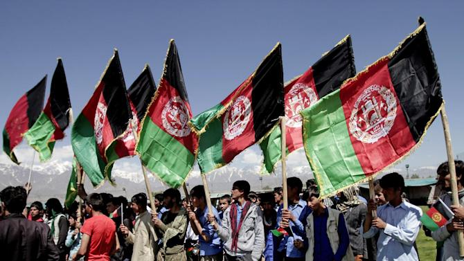 Protesters hold Afghanistan flags during a demonstration against Pakistan in Kochkin area on the outskirts of Kabul, Afghanistan, Monday, May 6, 2013. Afghanistan says it has lodged an official protest with Pakistan after its forces allegedly came under fire along a contested stretch of their border. The Foreign Ministry says the incident along the eastern frontier took place early Monday at the same location where a firefight between Afghan and Pakistani forces killed an Afghan border policeman and wounded two Pakistani soldiers last week. (AP Photo/Rahmat Gul)