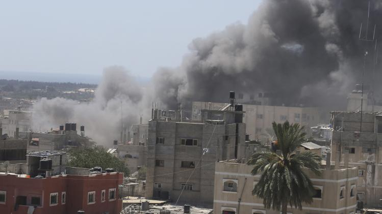 Smoke rises following what witnesses said was an Israeli air strike on a house in Rafah in the southern Gaza Strip