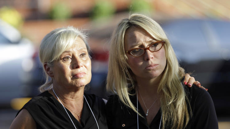 Donna Aldred, left, and her daughter, Leslie Lambert, right, listen during a news conference after the execution of Kimberly McCarthy at the Texas Department of Criminal Justice Huntsville Unit, where the death chamber is located, Wednesday, June 26, 2013, in Huntsville, Texas. Aldred's mother, Dorothy Booth, was killed by Kimberly McCarthy in 1997. McCarthy is the 500th person executed in Texas since 1982. (AP Photo/David J. Phillip)