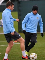 Manchester City&#39;s James Milner (L) and Carlos Tevez during a team training session on November 20. &quot;We need to take our chances. We had a number of corners (against Chelsea) and chances that didn&#39;t go our way,&quot; Milner said