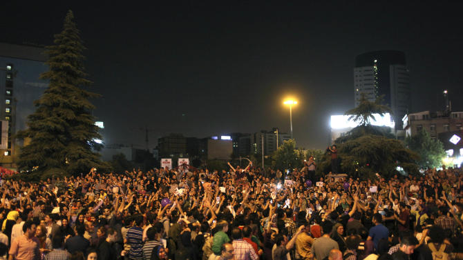 Supporters of Iranian presidential candidate Hasan Rowhani attend a celebration gathering following his victory, in Tehran, Iran, Saturday, June 15, 2013. Wild celebrations broke out on Tehran streets that were battlefields four years ago as reformist-backed Rowhani capped a stunning surge to claim Iran's presidency on Saturday, throwing open the political order after relentless crackdowns by hard-liners to consolidate and safeguard their grip on power. (AP Photo/Ebrahim Noroozi)