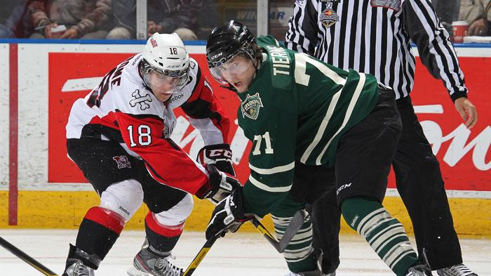 Ryan Strome of the Niagara IceDogs battles with Chris Tierney of the London Knights