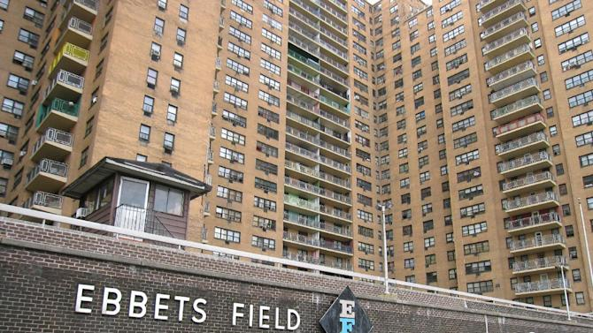 """This April 7, 2013 image shows the site of the Brooklyn Dodgers' ballpark, Ebbets Field, which was torn down after the Dodgers moved to Los Angeles in 1957 and is today an apartment complex in the Crown Heights neighborhood. A stone in the wall says """"This is the former site of Ebbets Field"""" while a faded sign in the courtyard says """"No ball playing.""""  A new movie, """"42,"""" tells the inspiring story of how Jackie Robinson integrated Major League Baseball when he played here for the Dodgers, beginning in 1947. (AP Photo/Beth J. Harpaz)"""