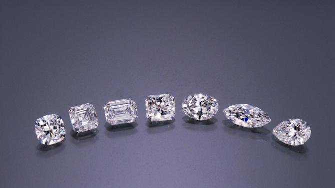 This publicity photo provided by Gemological Institute of America shows seven diamond cut shapes, from left to right: cushion, Asscher, emerald, modified radiant, oval, marquise, and pear. A simple round cut is the most common for modern diamond rings but some of the more unusual shapes, which have a retro look, are experiencing a resurgence, according to Melissa Colgan, senior style editor for Martha Stewart Weddings, because they are being seen on celebrities. (AP Photo/Gemological Institute of America)