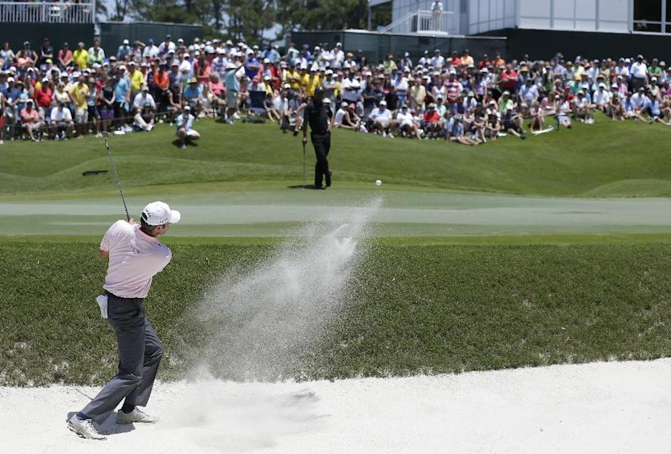 Matt Kuchar hits from a sand trap on the ninth hole during the second round of The Players championship golf tournament at TPC Sawgrass, Friday, May 10, 2013 in Ponte Vedra Beach, Fla. (AP Photo/Chris O'Meara)