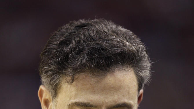 Louisville head coach Rick Pitino reacts during the second half of an NCAA Final Four semifinal college basketball tournament game against Kentucky Saturday, March 31, 2012, in New Orleans. (AP Photo/Mark Humphrey)