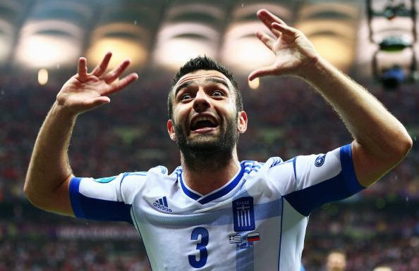 Giorgos Tzavelas of Greece celebrates victory and progress to the quarter finals during the UEFA EURO 2012 group A match between Greece and Russia at The National Stadium on June 16, 2012 in Warsaw, P