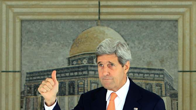 US Secretary of State John Kerry gestures upon his arrival for a meeting with Palestinian leader Mahmud Abbas in the West Bank city of Ramallah on July 23, 2014