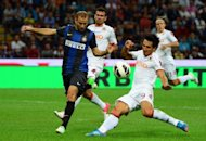 Inter Milan&#39;s Rodrigo Palacio (L) vies with AS Roma&#39;s Nicolas during their Serie A match, on September 2, in Milan, at the San Siro stadium. Both clubs are in action on Sunday, playing Torino and Bologna respectively