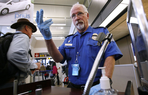 <p>               FILE - In this Jan. 4, 2010 file photo, TSA officer Robert Howard signals an airline passenger forward at a security check-point at Seattle-Tacoma International Airport in SeaTac, Wash. Flight attendants, pilots, federal air marshals and even insurance companies are part of a growing backlash to the Transportation Security Administration's new policy allowing passengers to carry small knives and sports equipment like souvenir baseball bats and golf clubs onto planes. (AP Photo/Elaine Thompson, File)
