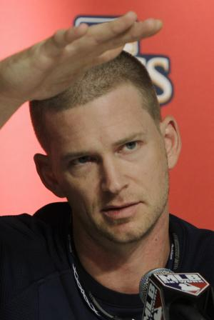 New York Yankees pitcher A.J. Burnett speaks at a press conference before Game 3 of baseball's American League Championship Series against the Texas Rangers on Monday, Oct. 18, 2010, in New York. (AP Photo/Paul Sancya)