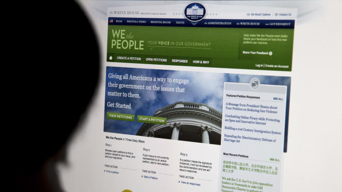 "The White House's online petition site called ""We the People""  is displayed on a computer screen in Beijing Sunday, May 12, 2013. Through the Obama administration's ""We the People"" site Chinese looking for justice have found a way to keep issues that our sometimes censored in their own country alive.  (AP Photo/Andy Wong)"