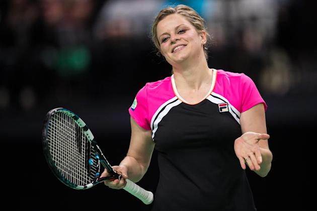 Belgium's Kim Clijsters reacts during an exhibition doubles tennis match against Belgium's Kirsten Flipkens and France's Henri Leconte at the Sportpaleis in Antwerp on Wednesday Dec. 11, 2