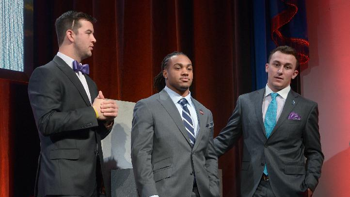 Alabama quarterback AJ McCarron, left, Auburn running back Tre Mason, center, and Texas A&M quarterback Johnny Manziel chat the College Football Awards show in Lake Buena Vista, Fla., Thursday, Dec. 12, 2013