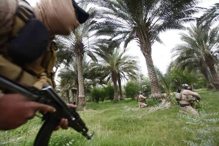 File photo of Iraqi security forces personnel taking part in clashes with the al Qaeda-linked Islamic State in Iraq and the Levant (ISIL) in Babel