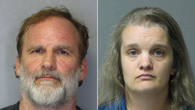 "This combination of photos released by the Delaware State Police shows Georgetown pediatrician Melvin Morse, 48, left, and his wife, Pauline Morse, 40. The couple have been charged with recklessly endangering their two daughters, including the use of a form of discipline that police say the Melvin Morse called ""waterboarding."" They were arrested Thursday, Aug. 9, 2012. (AP Photo/Delaware State Police)"