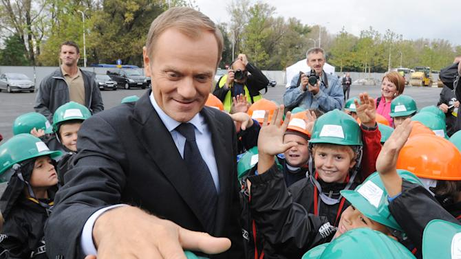 Polish Prime Minister Donald Tusk meets children at the National Stadium construction site, in Warsaw, Poland, Friday, Oct. 7, 2011. Tusk's centrist ruling party was campaigning hard to maintain its lead before weekend elections in Poland, fending off challenges from a new socially liberal party and a traditional rival that has accused it of responsibility for a plane crash that killed a generation of top politicians. (AP Photo/Alik Keplicz)