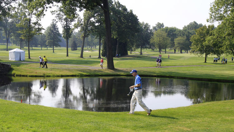 Jim Furyk walks past a lake to the third green during the second round of the Bridgestone Invitational golf tournament at Firestone Country Club, Friday, Aug. 3, 2012, in Akron, Ohio. (AP Photo/Tony Dejak)