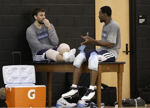 Memphis Grizzlies center Marc Gasol, left, talks with guard Tony Allen after a practice at NBA basketball training camp Tuesday, Oct. 1, 2013, in Nashville, Tenn. The Grizzlies are scheduled to hold t