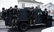 File picture shows a Seattle Police SWAT team. A gunman killed five people in a shooting spree in Seattle before turning the weapon on himself Wednesday as officers closed in, police said