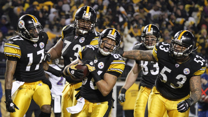 FILE - This Jan. 15, 2011, file photo shows Pittsburgh Steelers wide receiver Hines Ward (86) celebrating with teammates after scoring a touchdown against the Baltimore Ravens during the second half of an NFL divisional football game,  in Pittsburgh. NFL owners and players agreed early Monday, July 25, 2011  to the terms of a deal to end the lockout, and players were expected to begin the voting process later in the day, two people familiar with the negotiations told The Associated Press. The people spoke on condition of anonymity because the process was supposed to remain secret and no formal announcement had been made.(AP Photo/Gene J. Puskar, File)