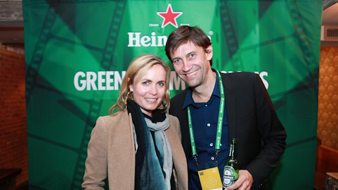 """IMAGE DISTRIBUTED FOR HEINEKEN - In this image released on Saturday, April 27, 2013, Filmmaker Nicholas Wrathall, right, of """"Gore Vidal"""" with actress Radha Mitchell at Heineken's Green Room Session during Tribeca Film Festival on Friday, April 26, 2013 in New York City. (Heineken via AP Images)"""