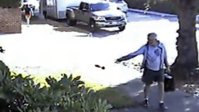 In this June 7, 2014 image from from a security video provided by Philip Lao, Dennis Kneier, the mayor of San Marino, Calif., tosses a bag of dog waste onto the property of his neighbor, Philip Lao, in San Marino. Kenier has apologized, saying he should have disposed of it properly. He said he was walking home from a park with his wife Saturday night when they found the bag on a parkway and he picked it up and tossed it onto a walkway at the property. Lao says he recognized Kneier on surveillance video and called police, who photographed the bag. (AP Photo/Courtesy Philip[ Lao)