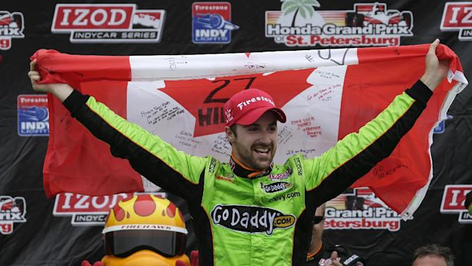 James Hinchcliffe, of Canada, celebrates in Victory circle after winning the IndyCar series Honda Grand Prix of St. Petersburg auto race Sunday  March 24, 2013, in St. Petersburg, Fla. (AP Photo/Chris O'Meara)