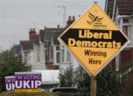 Political placards are displayed outside houses in Eastleigh, southern England February 28, 2013. REUTERS/Luke MacGregor