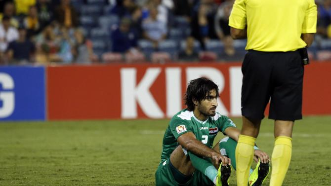 Iraq's Ahmed Ibrahim sits on the pitch after being given the red card for fouling UAE's Ali Mabkhout during their Asian Cup third-place playoff soccer match at the Newcastle Stadium in Newcastle