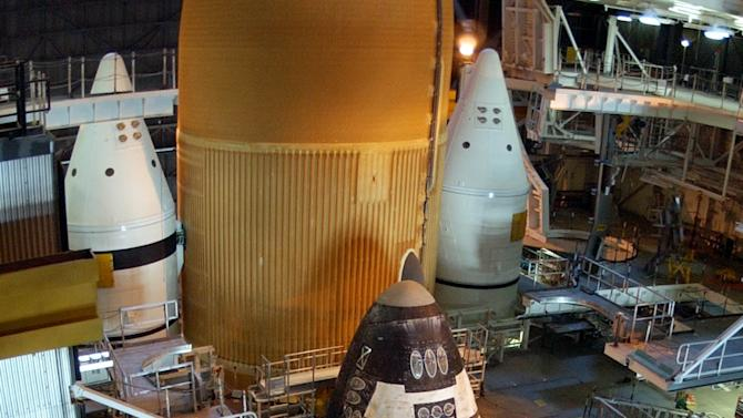 FILE - In this Tuesday, April 5, 2005 file picture, the space shuttle Discovery sits on the mobile launcher platform in the Vehicle Assembly Building at Kennedy Space Center in Cape Canaveral, Fla. (AP Photo/Peter Cosgrove/file)