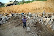North Korean workers lay rocks as they build a new road near the northeastern city of Rajin. North Korea has warned the South not to expect any major reforms under the leadership of Kim Jong-Un, with a senior official rejecting discussion of potential policy change as a &quot;foolish and silly dream&quot;