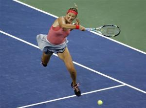 Victoria Azarenka of Belarus comes to the net against Daniela Hantuchova of Slovakia during their women's quarter-final match at the U.S. Open tennis championships in New York