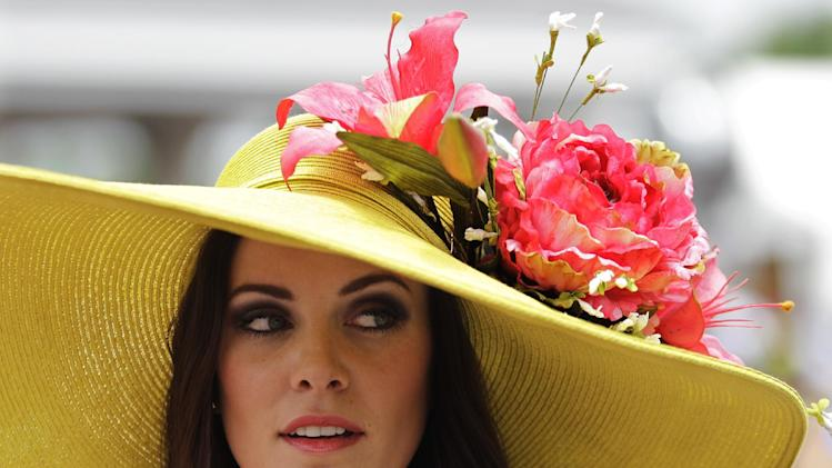 Tamara Sorrell, from Austin, Tx., wears a fancy hat in the paddocks before the 138th Kentucky Derby horse race at Churchill Downs Saturday, May 5, 2012, in Louisville, Ky. (AP Photo/Mark Humphrey)