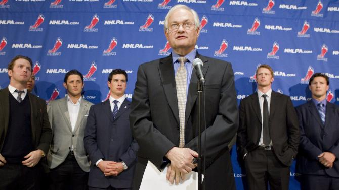 Donald Fehr, left, executive director of the NHL players' association, talks to reporters following collective bargaining talks between the NHLPA and the NHL in Toronto on Thursday, Oct. 18, 2012.  Players, from left, Detroit Red Wings' Daniel Cleary, Edmonton Oilers' Shawn Horcoff, Pittsburgh Penguins' Sidney Crosby, Carolina Hurricanes' Eric Staal and Phoenix Coyotes' Shane Doan listen in the background. (AP Photo/The Canadian Press, Chris Young)