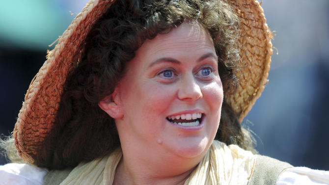 """An actor dressed as Shire folk warms up the crowd on the red carpet for the premiere of  """"The Hobbit: An Unexpected Journey"""" in Wellington, New Zealand, Wednesday, Nov. 28, 2012. (AP Photo/SNPA, Ross Setford) NEW ZEALAND OUT"""