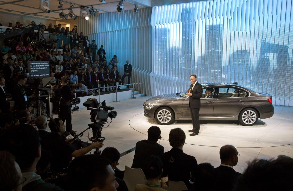 BMW Group's head of marketing Ian Robertson introduces the new BMW 3-series long wheel base 335L model  at the Beijing International Automotive Exhibition in Beijing, China Monday, April 23, 2012. (AP Photo/Andy Wong)