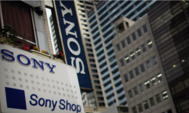 In this Thursday, Feb. 7, 2013 photo, Sony signs hang from a store in Tokyo. As the yen weakens, famous Japanese exporters are getting a boost but the favorable exchange rate also carries risks by ins