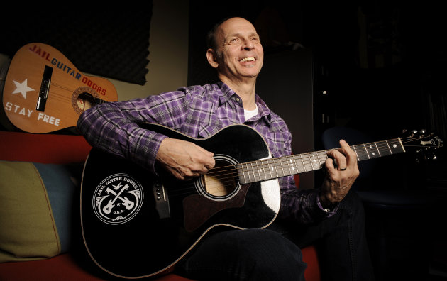 In this Jan. 16, 2012 photo, guitarist Wayne Kramer, founder of the band the MC5, plays one of the instruments that will be provided to jail inmates as part of the Jail Guitar Doors USA initiative at Kramer's recording studio in Los Angeles. The Jail Guitar Doors program provides instruments to inmates who are using music as a means of achieving rehabilitation. (AP Photo/Chris Pizzello)